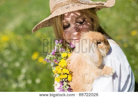 summer girl with bunny in the nature,
