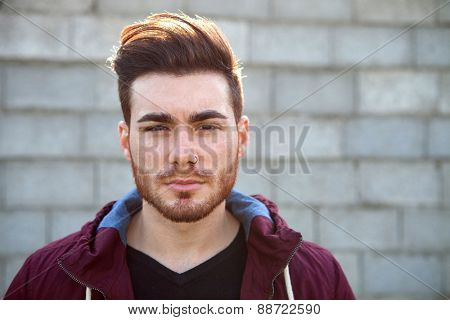 Casual cool young man with beard in the street