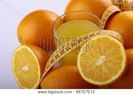 Orange Fruits, Juice And Measuring Tape