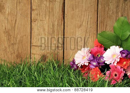 Bouquet of flowers in front of a fence.