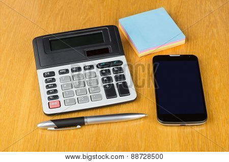 Modern Mobile Phone With Touchscreen, Paper, Calculator And Pen