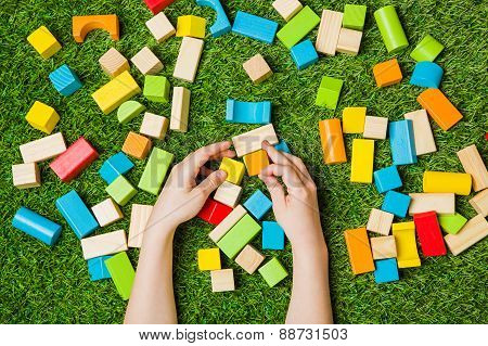 Creativly constructing from color wooden blocks