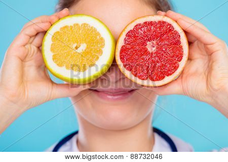 Nutritionist Covering Her Eyes With Fruits