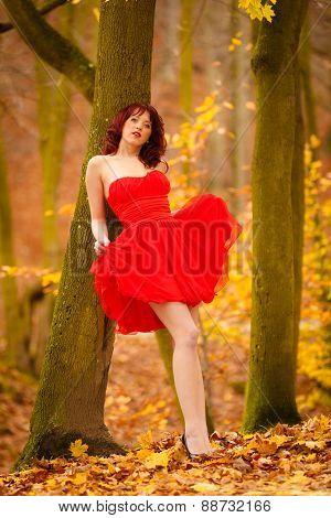 Fashion Woman Red Dress Relaxing Walking In Park