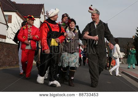 TURNOW, GERMANY - MARCH 12, 2011: Young people attend the Zampern Carnival in the Lusatian village of Turnow near Cottbus, Lower Lusatia, Brandenburg, Germany.
