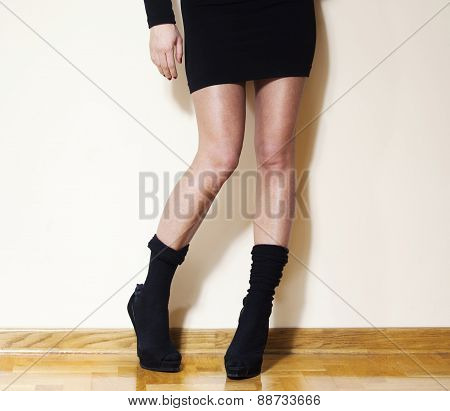 Woman Fashion Model In Black Sexy Skirt And Wool Stockings And High Heel Shoes