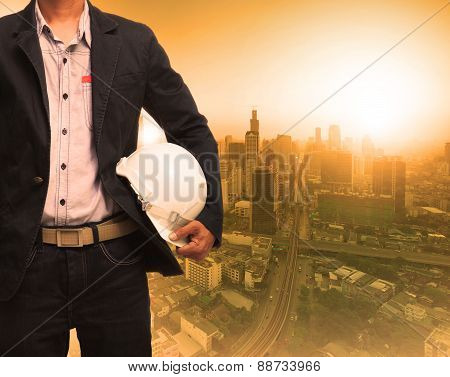 Engineering Man And Sun Light Behind Urban Construction Background Use For Land Development Theme
