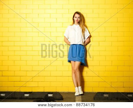 Hipster Fashion Girl at the Yellow Wall
