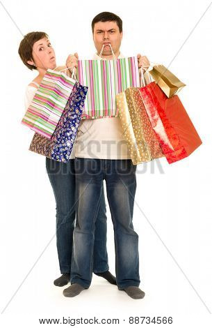 man hold in teeth shopping bags and woman