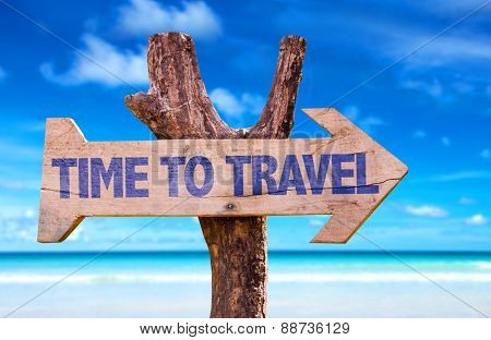 Time To Travel wooden sign with beach background