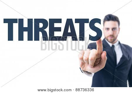 Business man pointing the text: Threats