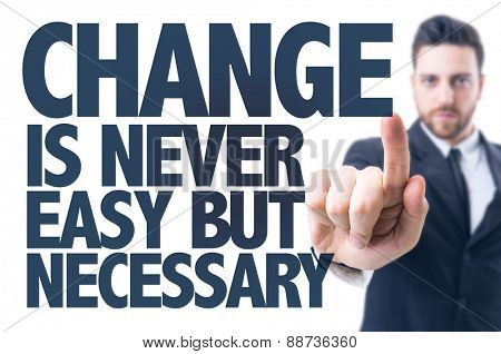 Business man pointing the text: Change Is Never Easy But Necessary