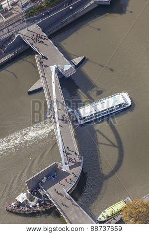 Top down aerial view of people crossing a footbridge in downtown Melbourne