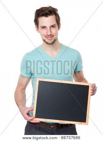 Caucasian man show with chalkboard