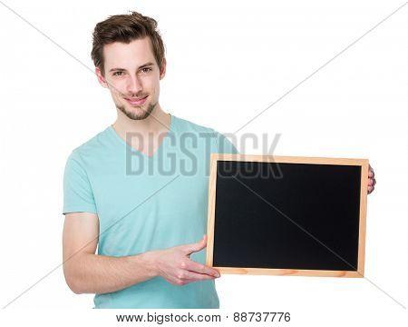 Caucasian man show with blackboard