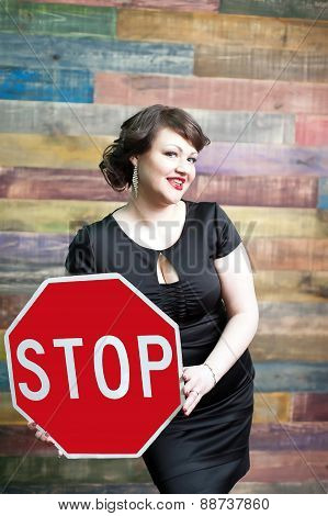 woman with traffic sign