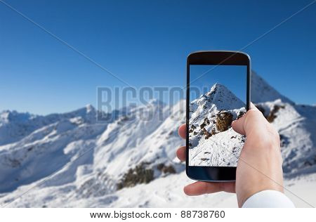 Man Holding Credit Card And Cell Phone