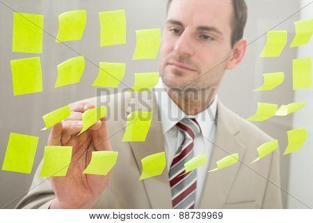 Businessman Looking At Adhesive Notes