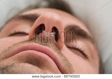 Man Face With Nose Clip Device