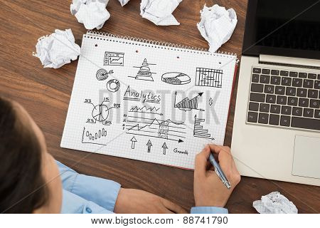 Businesswoman Making Chart On Paper