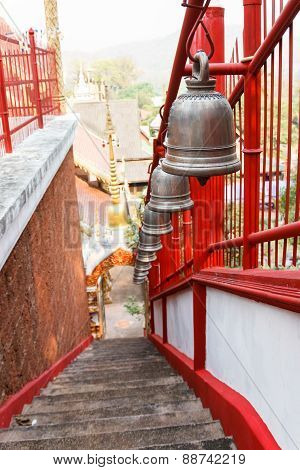 Alloy Bell On The Stairway In Asian Temple