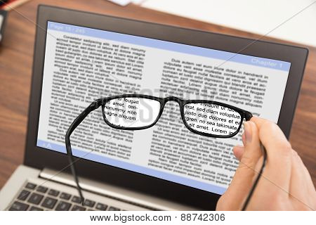 Person Hand With Spectacles And Laptop
