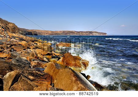Orange Rocks On Sunny Shore In Spring