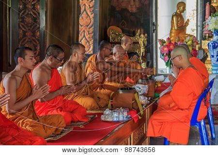 Monks Praying In Wat Kaew Korawaram Temple