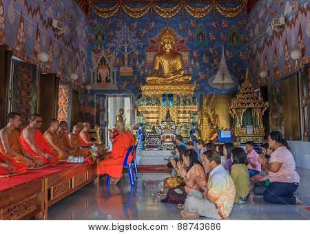 Worshipers And Monks Praying In Wat Kaew Korawaram Temple