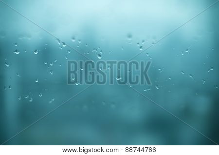Mirror With Rain Drops With Blur Effect In Aqua Blue Color Background
