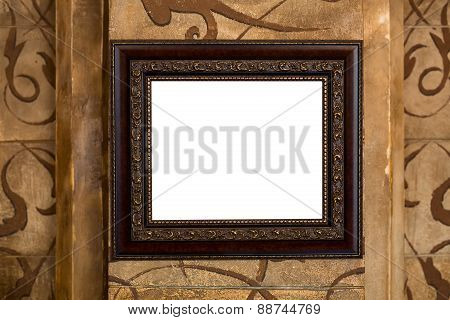 Wooden old frame on the wall with empty content