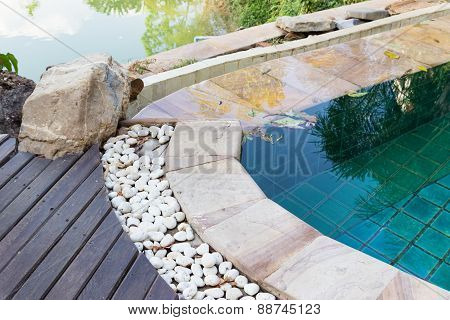 Edge Of The Swimming Pool Decorating With White Stone