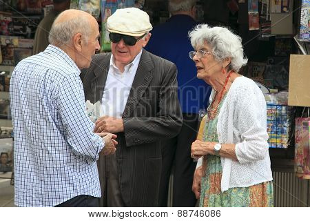 Venice, Mestre-june 29, 2014. Two Elderly Men And Women Talking On Piazza Erminio Ferretto In Italy.