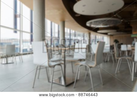 Blurry Defocused Image Of Table And Chair In Food Court For Background