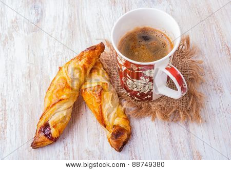 Cup Of Coffee And Homemade Yeast Croissants