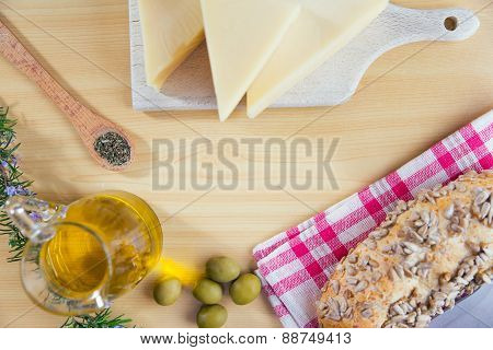 Integral rolls on the wooden table, olive, oil olive, cheese