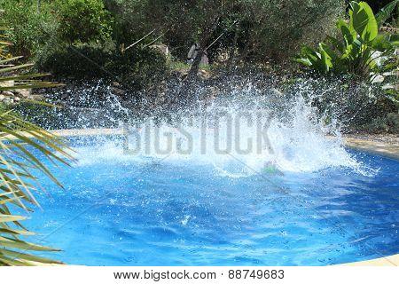 Big water splash in the pool