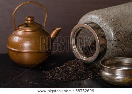 Scattered Dry Tea, Old  Jar And A Vintage Teapot