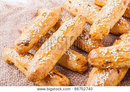 Salt Finger Cakes With Onion And Sesame Seeds On A Plate
