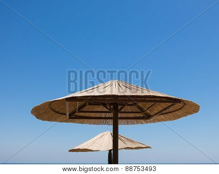 Two Parasols Made Of Straw
