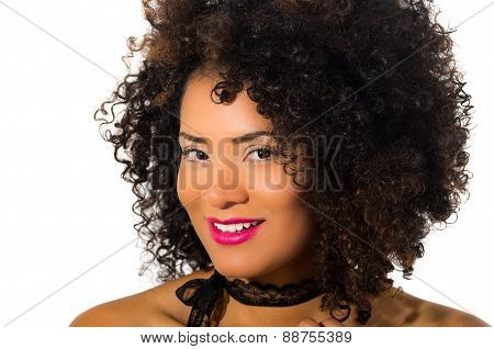 exotic beautiful young girl with dark curly hair posing