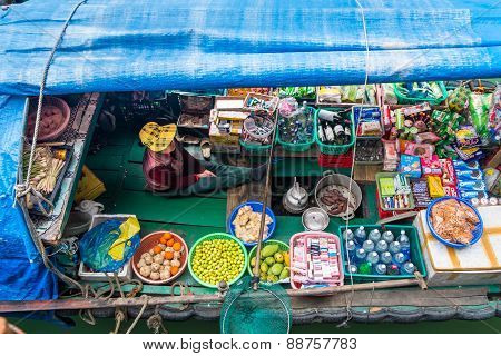 Woman Selling Goods From A Boat In Vietnam