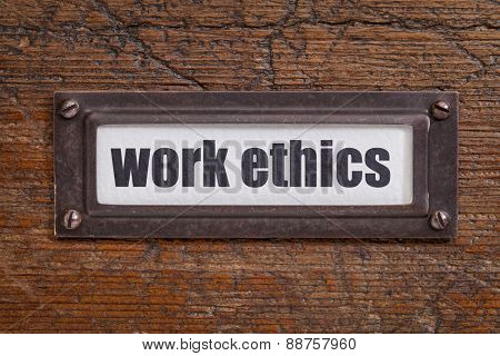 work ethics - file cabinet label, bronze holder against grunge and scratched wood