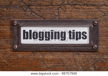 blogging tips  - file cabinet label, bronze holder against grunge and scratched wood