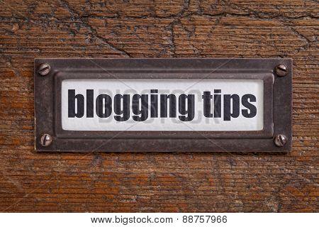 blogging tips  - file cabinet label, bronze holder against grunge and scratched wood