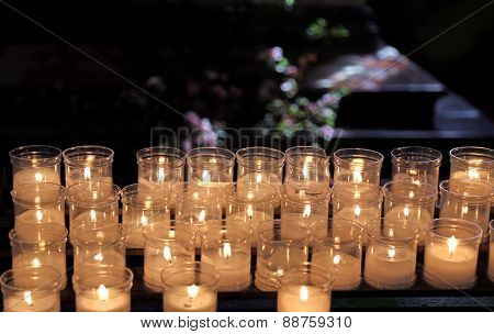 Lit Candles To Pray Inside A Church