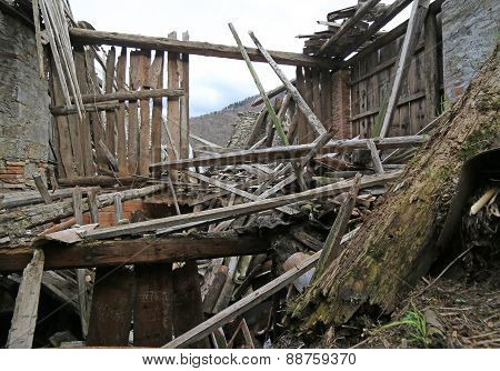 House In Ruins And Abandoned With The Roof Destroyed In The Mountains