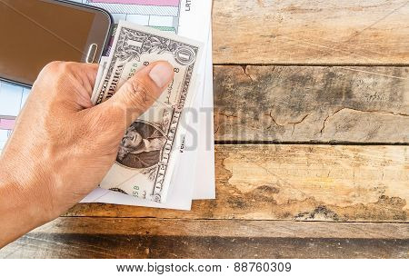 Hand Holding Dollar Money