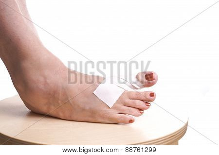 Foot With Therapeutic Self Adhesive Tape
