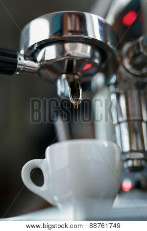 preparing espresso on professional coffee machine